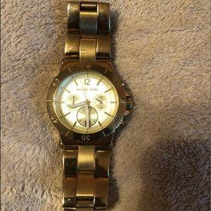 Gold MK big faced watch